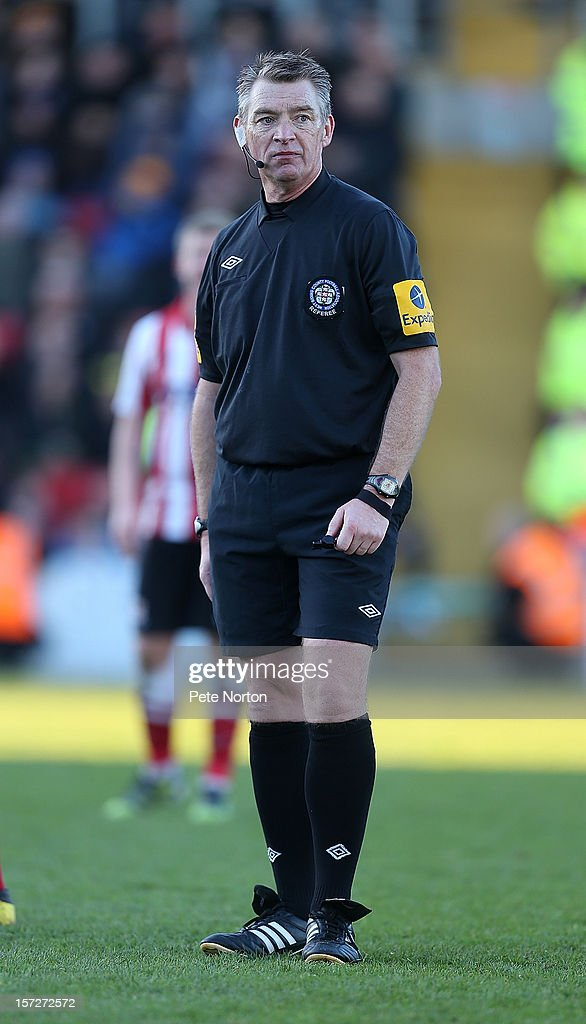 Referee Mark Haywood in action during the FA Cup with Budweiser Second Round match at Sincil Bank Stadium on December 1, 2012 in Lincoln, England.