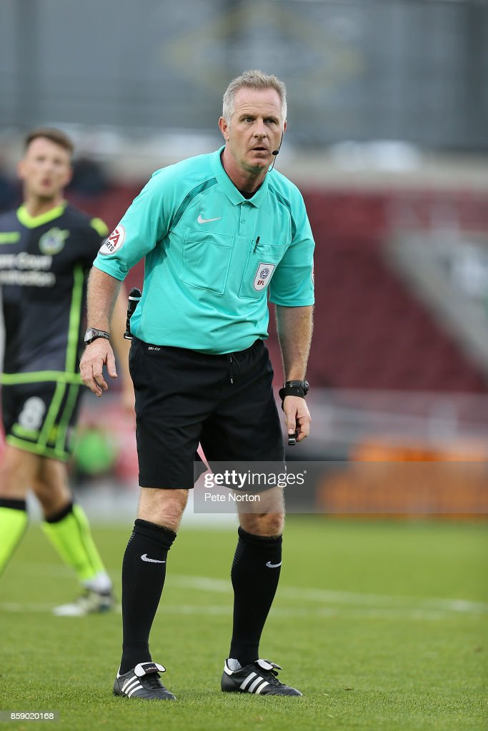 Referee Mark Heywood in action during the Sky Bet League One match between Northampton Town and Bristol Rovers at Sixfields on October 7, 2017 in Northampton, England.