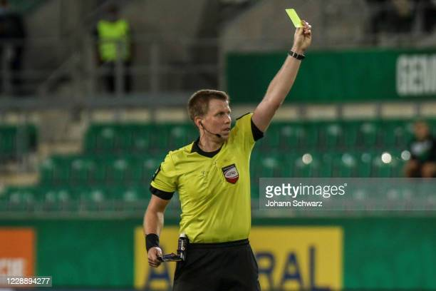 Referee Markus Hameter shows the yellow card during the tipico Bundesliga match between SK Rapid Wien and LASK at Allianz Stadion on October 4 2020...