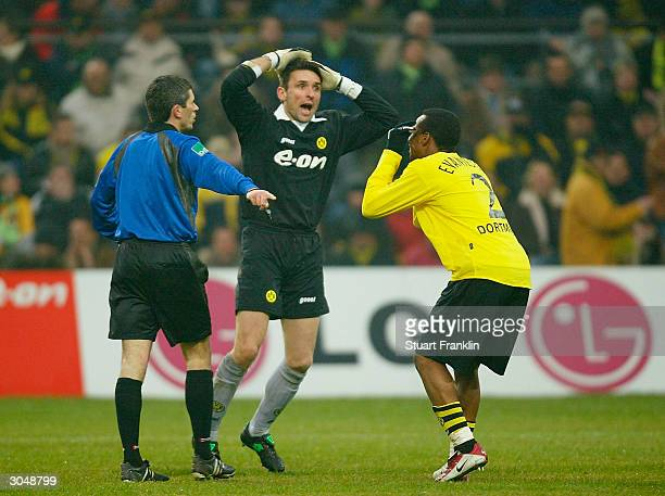 Referee Markus Merk points to the penalty spot as Guillaume Warmuz and Evanilson of Dortmund protest during The Bundesliga match between Borussia...