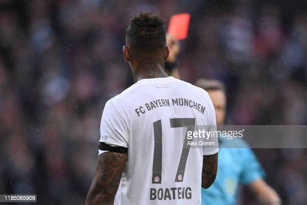 Referee Markus Schmidt sghows the red card to Jerome Boateng of Muenchen during the Bundesliga match between Eintracht Frankfurt and FC Bayern...