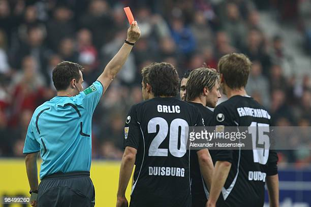 Referee Markus Schmidt shows Kristoffer Andersen of Duisburg the red card during the Second Bundesliga match between FC Augsburg and MSV Duisburg at...