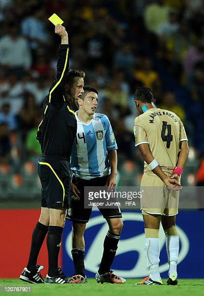 Referee Markus Strombergsson shows a yellow card for both Adrian Martinez of Argentina and Mohamed Abdel Fatah of Egypt during the FIFA U20 World Cup...