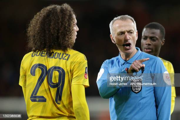 Referee Martin Atkinson argues with Matteo Guendouzi of Arsenal during the FA Cup Fourth Round match between Bournemouth and Arsenal at Vitality...