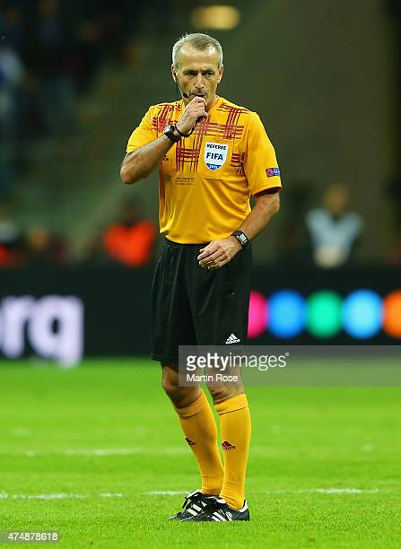 Referee Martin Atkinson blows his whistle during the UEFA Europa League Final match between FC Dnipro Dnipropetrovsk and FC Sevilla on May 27 2015 in...