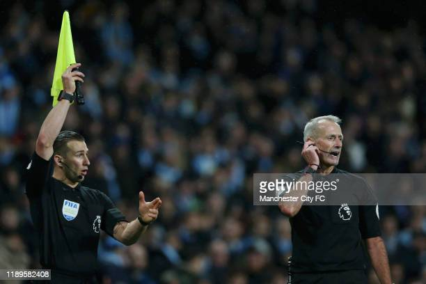 Referee Martin Atkinson consults VAR decision which rules out Manchester City's third goal during the Premier League match between Manchester City...