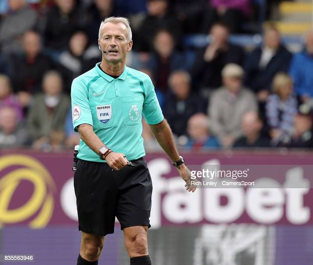 Referee Martin Atkinson during the Premier League match between Burnley and West Bromwich Albion at Turf Moor on August 19 2017 in Burnley England