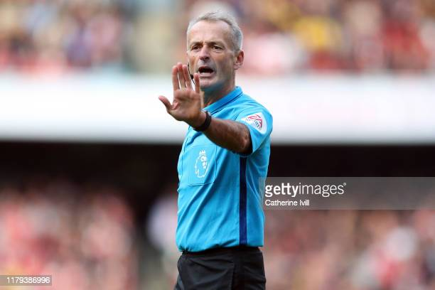 Referee Martin Atkinson during the Premier League match between Arsenal FC and AFC Bournemouth at Emirates Stadium on October 06, 2019 in London,...