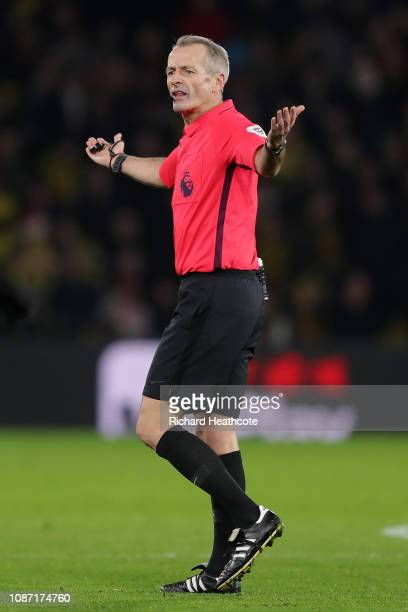 Referee Martin Atkinson gestures during the Premier League match between Watford FC and Chelsea FC at Vicarage Road on December 26 2018 in Watford...
