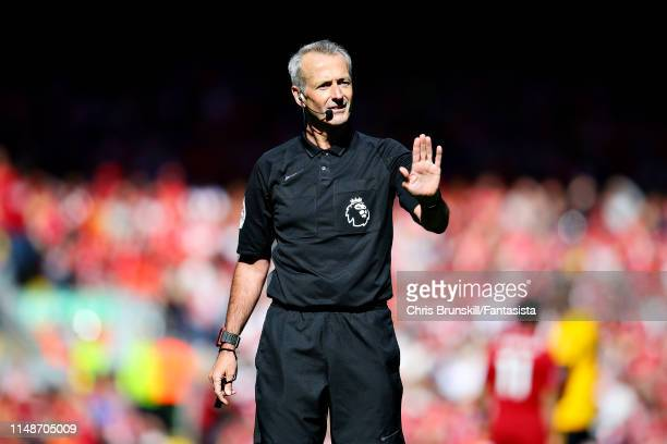Referee Martin Atkinson gestures during the Premier League match between Liverpool FC and Wolverhampton Wanderers at Anfield on May 12 2019 in...