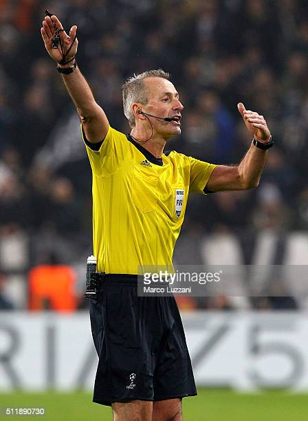 Referee Martin Atkinson gestures during the UEFA Champions League Round of 16 first leg match between Juventus and FC Bayern Muenchen at Juventus...