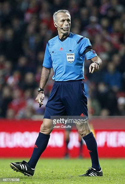 Referee Martin Atkinson gestures during the UEFA EURO 2016 qualifier playoff second leg match between Denmark and Sweden at Telia Parken stadium on...