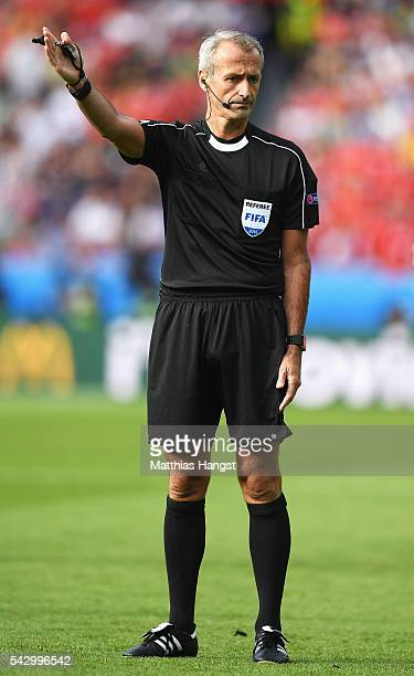 Referee Martin Atkinson gestures during the UEFA EURO 2016 round of 16 match between Wales and Northern Ireland at Parc des Princes on June 25 2016...