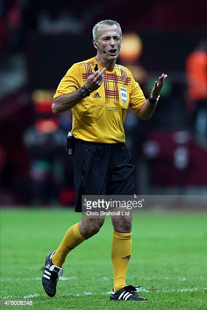 Referee Martin Atkinson gestures during the UEFA Europa League Final match between FC Dnipro Dnipropetrovsk and FC Sevilla at the National Stadium on...