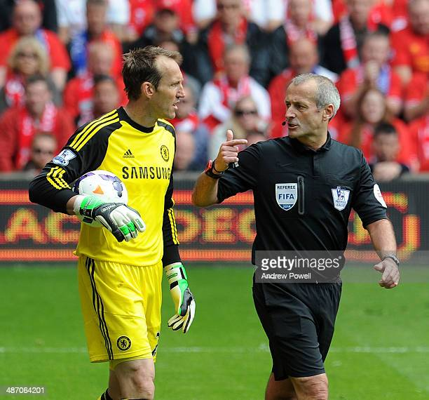 Referee Martin Atkinson has words with goalkeeper Mark Schwarzer of Chelsea during the Barclays Premier League match between Liverpool and Chelsea at...