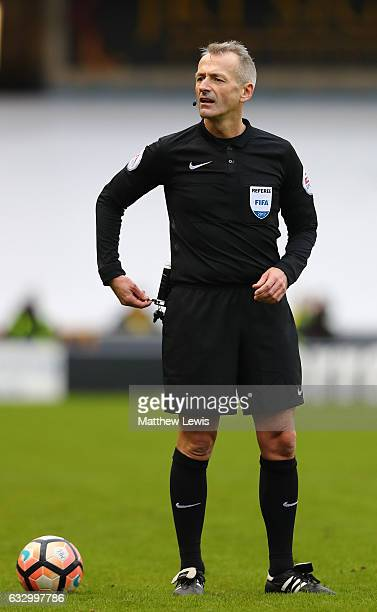 Referee Martin Atkinson in action during The Emirates FA Cup Fourth Round match between Millwall and Watford at The Den on January 29 2017 in London...