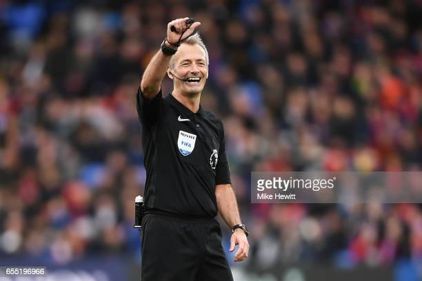 Referee Martin Atkinson in action during the Premier League match between Crystal Palace and Watford at Selhurst Park on March 18 2017 in London...