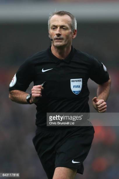 Referee Martin Atkinson looks on during the Emirates FA Cup Fifth Round match between Blackburn Rovers and Manchester United at Ewood Park on...