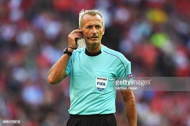 Referee Martin Atkinson looks on during the International Champions Cup match between Liverpool and Barcelona at Wembley Stadium on August 6 2016 in...