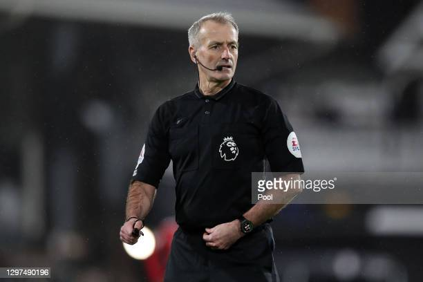 Referee, Martin Atkinson looks on during the Premier League match between Fulham and Manchester United at Craven Cottage on January 20, 2021 in...