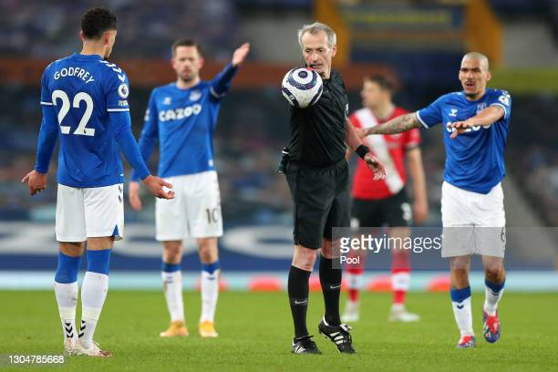 Referee Martin Atkinson looks on during the Premier League match between Everton and Southampton at Goodison Park on March 01, 2021 in Liverpool,...