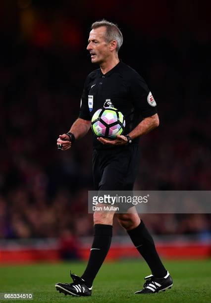 Referee Martin Atkinson looks on during the Premier League match between Arsenal and West Ham United at Emirates Stadium on April 5 2017 in London...