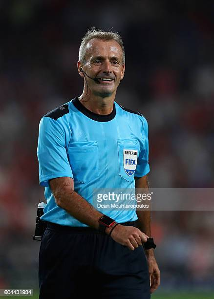 Referee Martin Atkinson looks on during the UEFA Champions League Group D match between PSV Eindhoven and Club Atletico de Madrid at Philips Stadion...