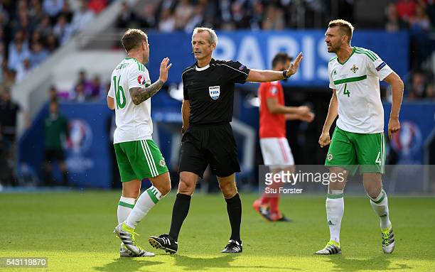 Referee Martin Atkinson makes a decsion during the Round of 16 UEFA Euro 2016 match between Wales and Northern Ireland at Parc des Princes on June 25...