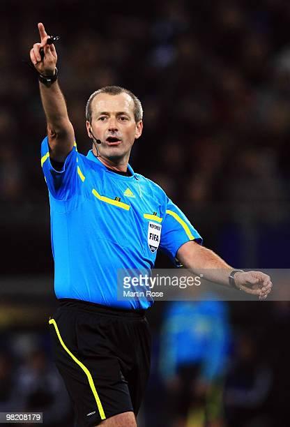 Referee Martin Atkinson makes a point during the UEFA Europa League quarter final first leg match between Hamburger SV and Standard Liege at HSH...