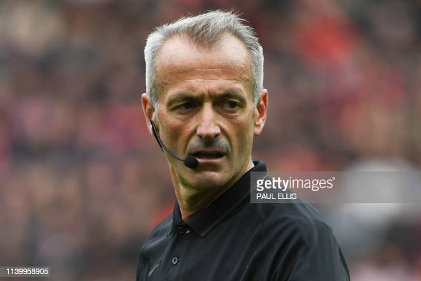 Referee Martin Atkinson officiates during the English Premier League football match between Manchester United and Chelsea at Old Trafford in...