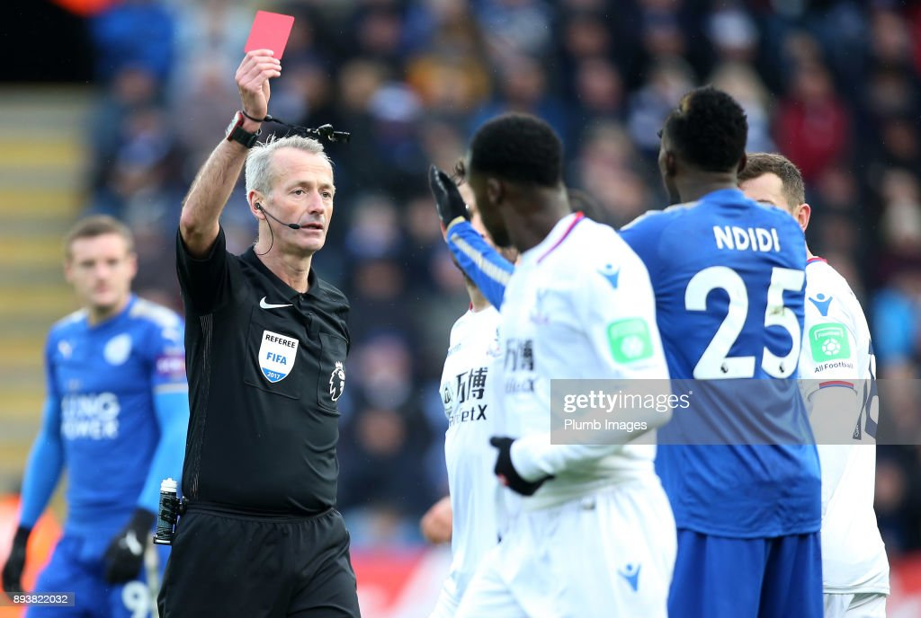 Referee Martin Atkinson shows a red card to Wilfred Ndidi of Leicester City during the Premier League match between Leicester City and Crystal Palace at King Power Stadium on December 16th , 2017 in Leicester, United Kingdom.