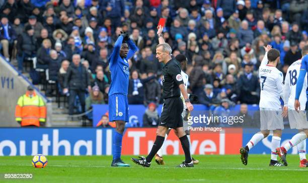 Referee Martin Atkinson shows a red card to Wilfred Ndidi of Leicester City during the Premier League match between Leicester City and Crystal Palace...