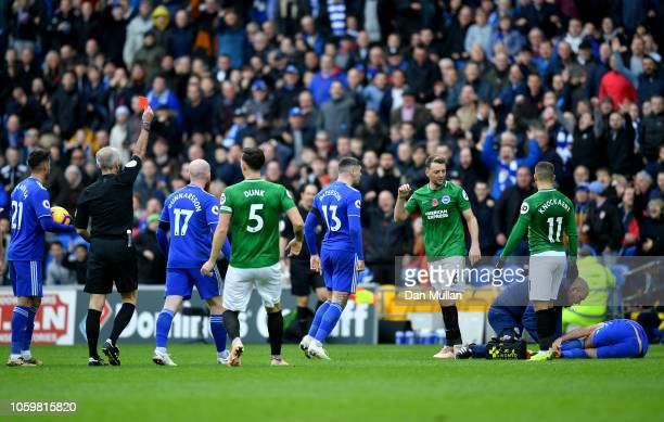 Referee Martin Atkinson shows Dale Stephens of Brighton and Hove Albion a red card during the Premier League match between Cardiff City and Brighton...
