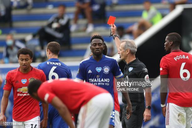 Referee Martin Atkinson shows the red card to Leicester City's Northern Irish defender Jonny Evans during the English Premier League football match...