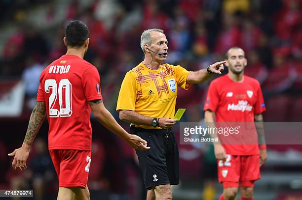 Referee Martin Atkinson shows the yellow card during the UEFA Europa League Final match between FC Dnipro Dnipropetrovsk and FC Sevilla on May 27...