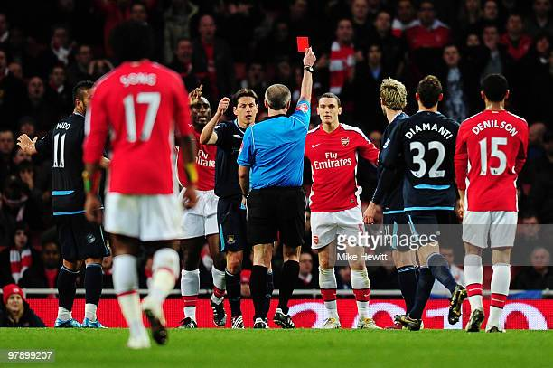 referee Martin Atkinson shows Thomas Vermaelen of Arsenal the red card during the Barclays Premier League match between Arsenal and West Ham United...