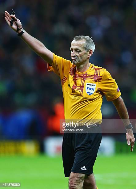 Referee Martin Atkinson signals during the UEFA Europa League Final match between FC Dnipro Dnipropetrovsk and FC Sevilla on May 27 2015 in Warsaw...