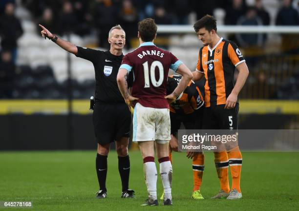 Referee Martin Atkinson speaks to Ashley Barnes of Burnley during the Premier League match between Hull City and Burnley at KCOM Stadium on February...