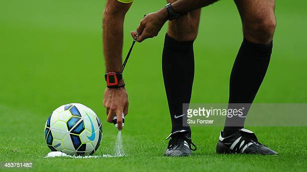 Referee Martin Atkinson sprays his magic free kick line spray during the Barclays Premier League match between Newcastle United and Manchester City...