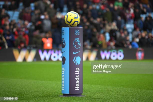 Referee Martin Atkinson takes the match ball from a 'Heads Up' branded plinth during the Premier League match between Aston Villa and Tottenham...