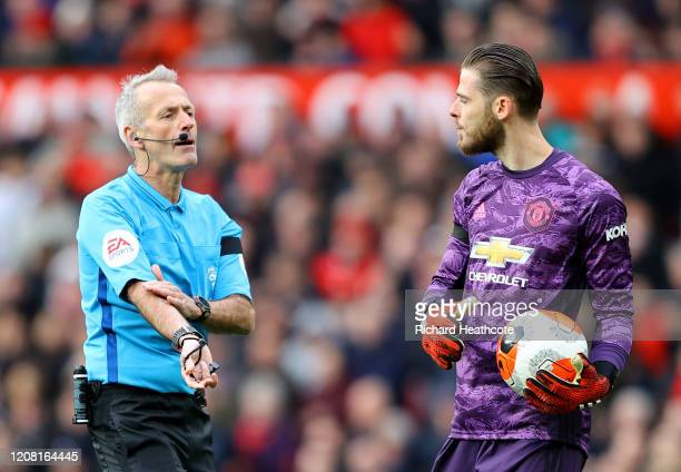 Referee Martin Atkinson talks to David De Gea of Manchester United during the Premier League match between Manchester United and Watford FC at Old...