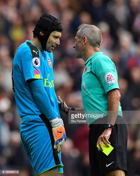 Referee Martin Atkinson talks to Petr Cech of Arsenal before showing an yellow card during the Premier League match between Sunderland and Arsenal at...