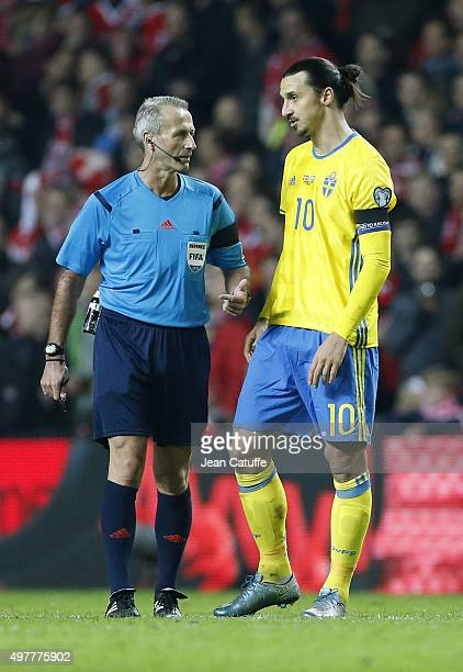 Referee Martin Atkinson talks to Zlatan Ibrahimovic of Sweden during the UEFA EURO 2016 qualifier playoff second leg match between Denmark and Sweden...