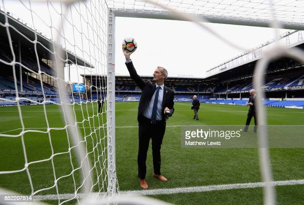 Referee Martin Atkinson tests the goal line techonolgy prior to the Premier League match between Everton and AFC Bournemouth at Goodison Park on...