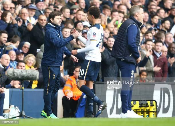 Referee Martin AtkinsonTottenham Hotspur manager Mauricio Pochettino shanks hands with Tottenham Hotspur's Dele Alli during the The Emirates FA Cup...