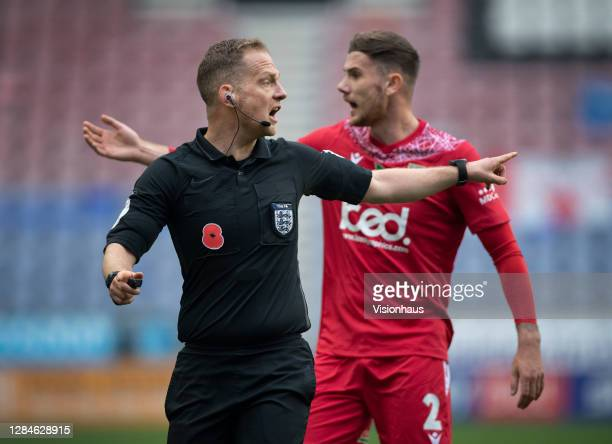 Referee Martin Coy ignores the protests of Arlen Birch of Chorley FC during the FA Cup First Round match between Wigan Athletic and Chorley on...