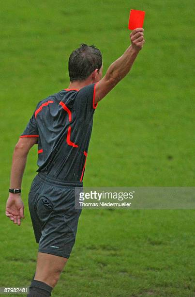 Referee Martin Kempter shows the red card during the Regionalliga match between 1 FC Heidenheim and SSV Ulm at the Albstadion stadium on May 26 2009...