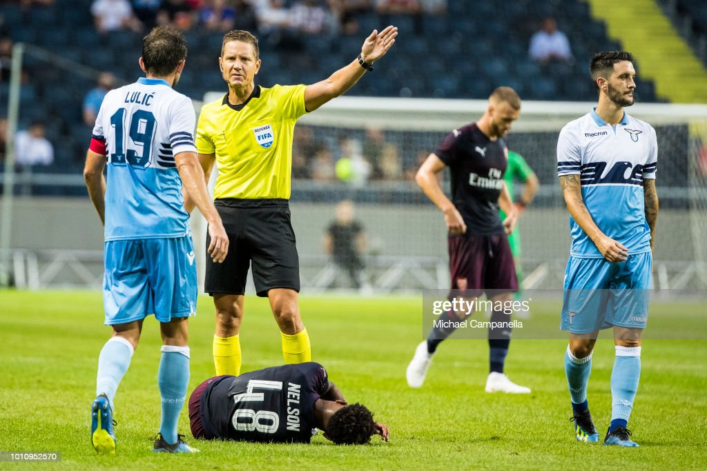 Referee Martin Strombergsson awards a free kick to Arsenal FC after a foul from SS Lazio Senad Lulic on Arsenal's Reiss Nelson during the Pre-season friendly between Arsenal and SS Lazio at Friends Arena on August 4, 2018 in Stockholm, Sweden.