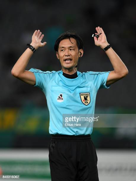 Referee Masaaki Iemoto gestures during the JLeague J2 match between Tokyo Verdy and Matsumoto Yamaga at Ajinomoto Stadium on September 10 2017 in...