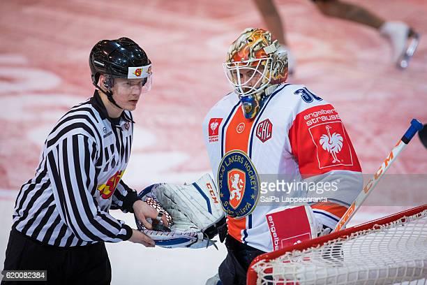 Referee Masi Puolakka and Joachim Eriksson of Vaxjo during the Champions Hockey League Round of 16 match between SaiPa Lappeenranta and Vaxjo Lakers...